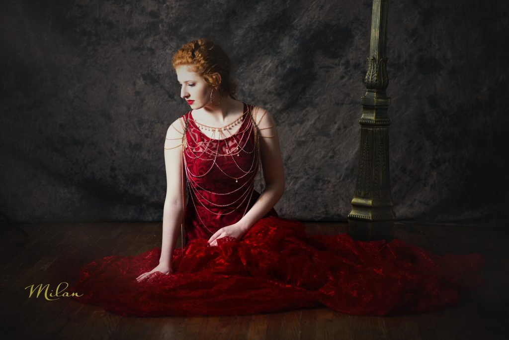 Girl in red dress sitting on floor