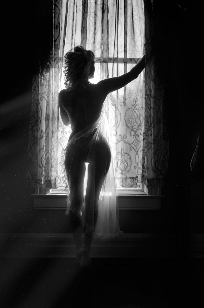 Silhouette woman in window