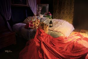 Little red riding hood at grandmas bed