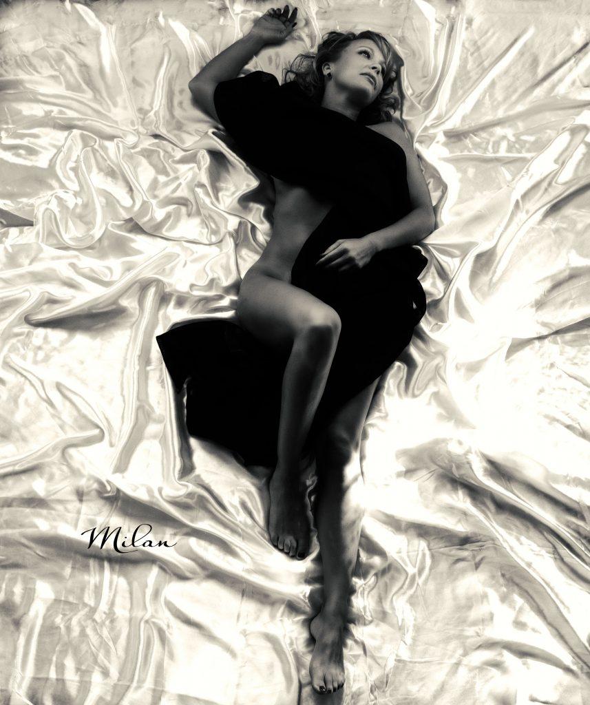 Girl on satin sheets